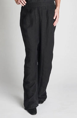 Model wears Eadie Lifestyle The Classic Wide Leg Pant in Black. Wears with black heels. Front view.