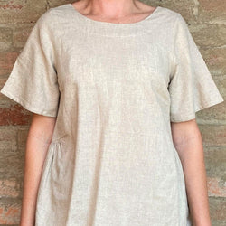 Somebody's Story brand Alicia Top, natural oatmeal colour, with round neck and sleeves, front view.