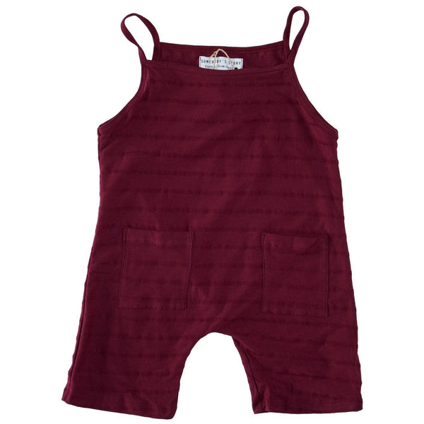 Somebody's Story brand kids dungarees in maroon colour.  3/4 length pants with two front pockets and thin shoulder straps.