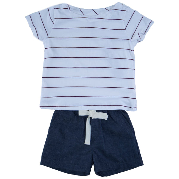Somebody's Story brand kids shorts in navy with elasticised waist and contrast tie in white. Paired with red striped t-shirt.