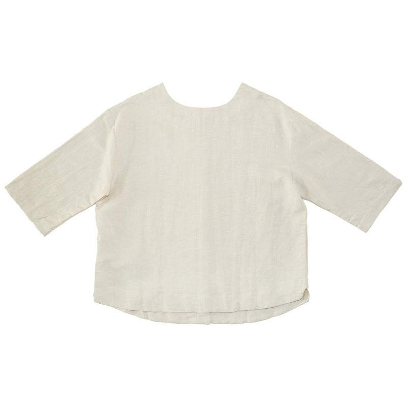 Somebody's Story brand Leonie Top in natural coloured linen. Round, high neck with 3/4 length sleeves and curved hem.