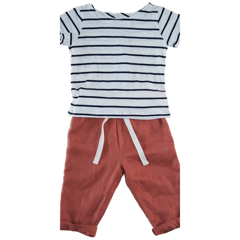 Somebody's Story brand kids pants in rust coloured fabric.   Elasticised waist with white contrast tie.  Rolled hem.  Paired with black and white striped kids casual tee.