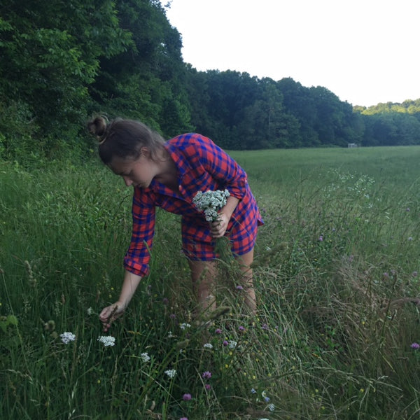 Megan Cox picking yarrow flowers for Farm to Face