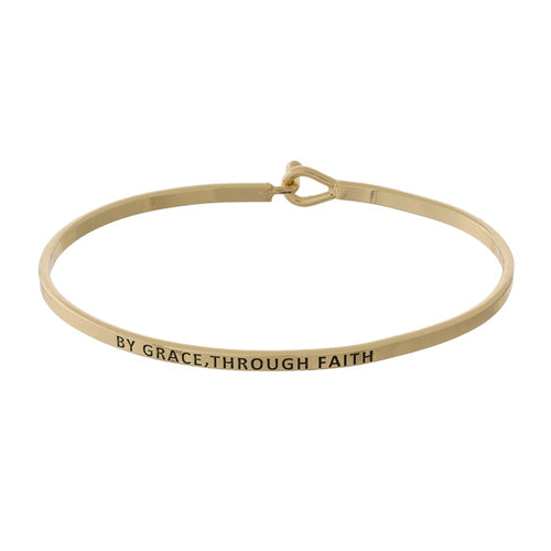 Metal bracelet with engraved message,