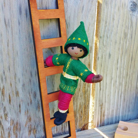 African American Kindness Elf climbing a ladder