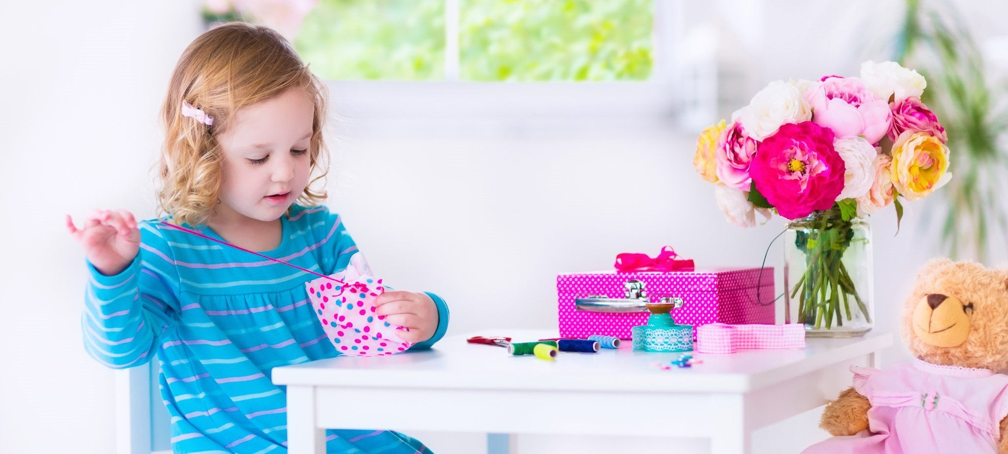 Little girl sewing and crafting