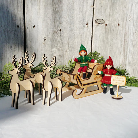 Kindness Elves in Santa's sleigh with wooden reindeer