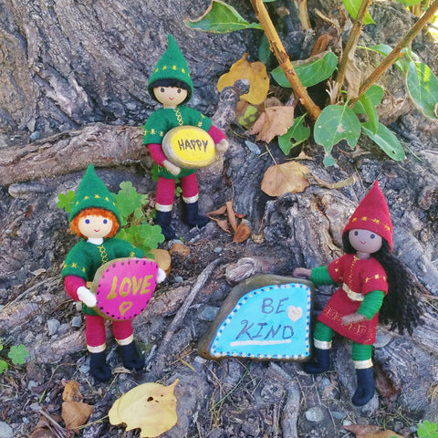 The kindness elves placing word rocks around town