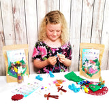 Cute little girl making bendy doll fairy Wildflower Toys craft kit