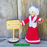 Mrs. Claus with Kindness Elves sign