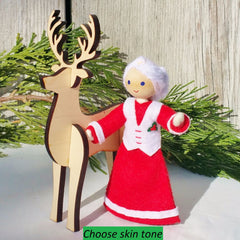 Mrs. Claus with wooden reindeer