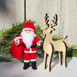 Santa Claus doll with wooden reindeer
