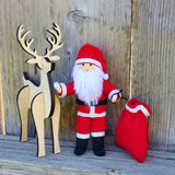 Santa Claus with wooden reindeer