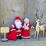 Santa Claus and Mrs Claus doll with wooden reindeer