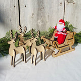 Santa Claus doll with wooden sleigh and reindeer