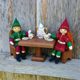 Kindness Elf dolls sitting at a table Kindness Tradition