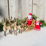 Santa Claus doll with Mrs Claus, wooden sleigh and reindeer