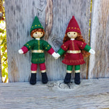 Cute Kindness Elf dolls holding hands. Light brown hair