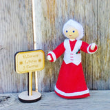Mrs. Claus doll with Kindness Elves sign