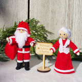 Santa Claus and Mrs. Claus Dolls Kindness Elves sign