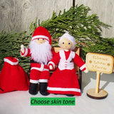 Santa Claus and Mrs. Claus Dolls sitting on bench