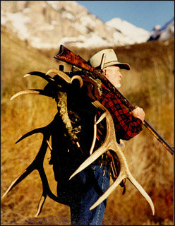 Bob Parker of Parker Productions  carrying elk antlers on his back