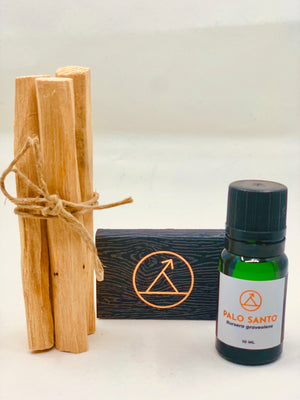 Palo Santo Ritual Kit containing 100% palo santo essential oil, matchbook and Palo Santo wood sticks