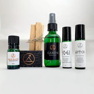 Meditation bundle containing palo santo essential oil, palo santo sticks, matchbook, Ritual Mist, Roll On Blends