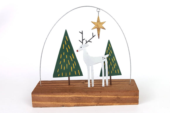 Silver deer on wood shelf decoration