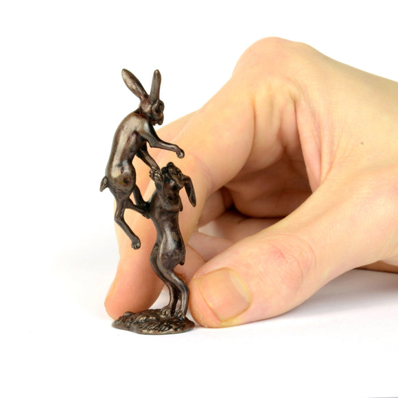 Boxing hares - miniature bronze sculpture by David Meredith