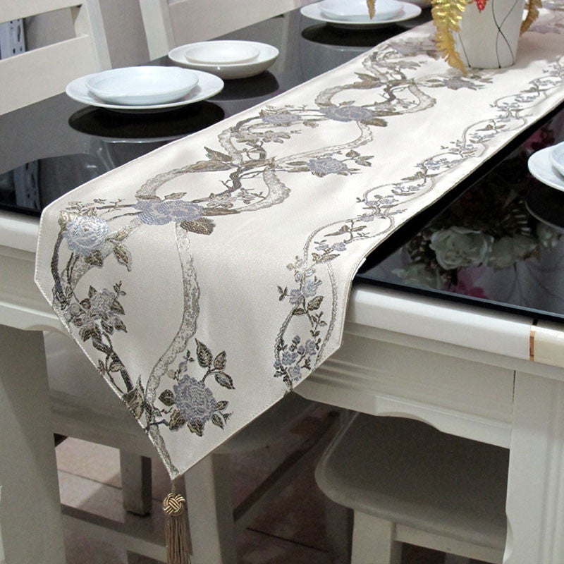 Beige Table Runner with Silver Toned Rose Motif and Ball Topped Fringes TR12