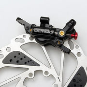Ultimo, Cable-actuated Hydraulic Disc Brake.