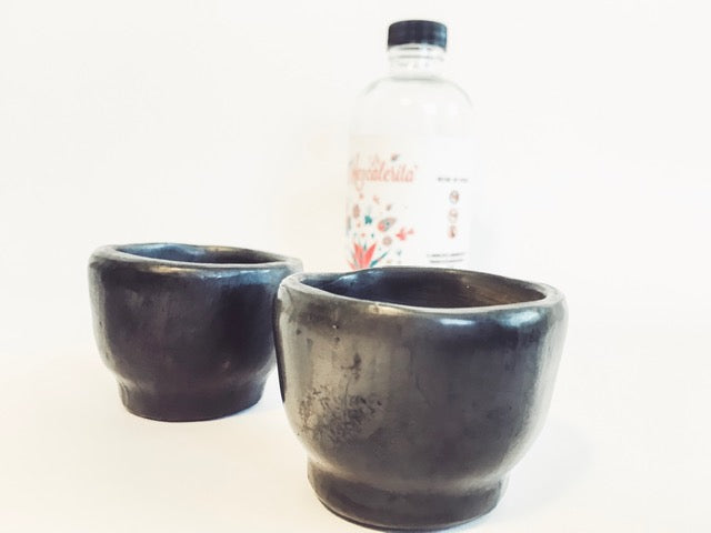 Made of barro negro (black clay) these ceramic mezcal cups are handmade by artisans in Oaxaca, Mexico. This unique Mexican pottery is perfect for sipping smoky mezcal.