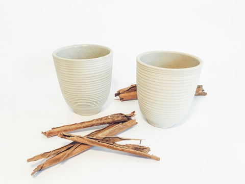 These hand-thrown ceramic chai cups are made of creamy-colored, natural stoneware and glaze finished on the inside. Using environmentally friendly methods, produced by artisans in Rajasthan, India.
