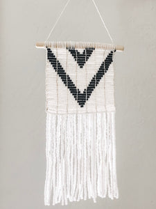 This beautifully beaded wall hanging was intricately crafted by the Maasai Mamas of Sidai Designs in Tanzania, East Africa. These pieces celebrate the traditional designs of Maasai beadwork and provide a source of sustainable income for the women artisans who create them.