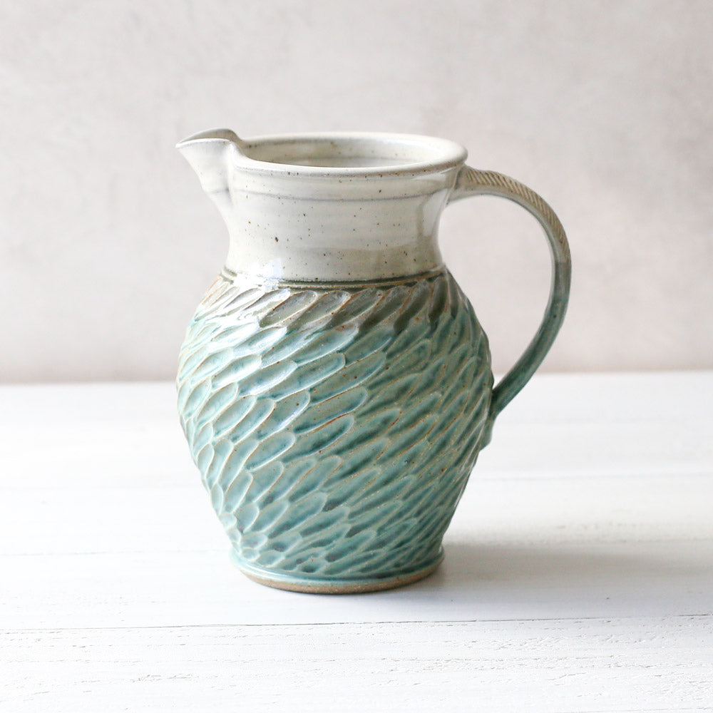 Carved Pottery Pitcher