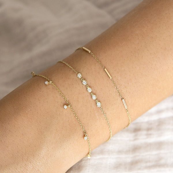 5 LINKED FLOATING DIAMONDS BRACELET - 14K YELLOW GOLD