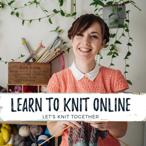 White Woman is knitting and smiling