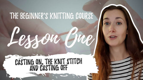 White Woman in Stripey Top holding knitting needles