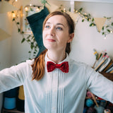 White Girl wearing a Red Gold Bow Tie