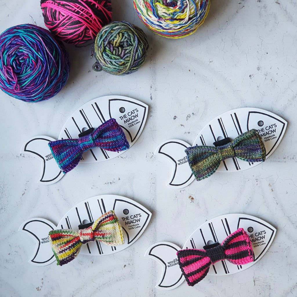 Four Multi coloured Knitted Cat Bow Ties with Balls of Yarn
