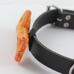 Side view of an Orange Knitted Dog Bow Tie attached to a black collar