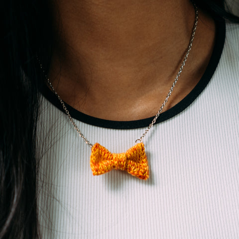 Orange Mini Bow Tie Necklace on Brown Skin
