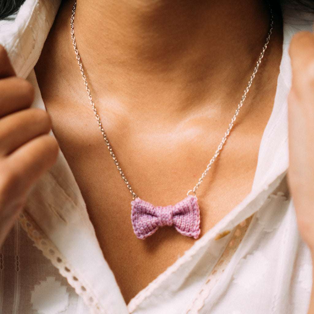 Mini Pink Bow Tie Necklace on Brown Skin