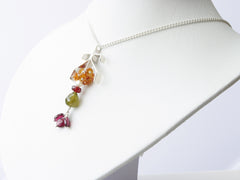 Ardwinna necklace. Handmade polished sterling silver 'umbrella' shape from which hangs a cluster of hessonite garnets with pearl, garnet and olive green vesuvianite.  Sterling silver chain. Harmony Collection. 46cm chain, pendant 5cm long