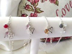 Selection of sterling silver charm bracelets from Jewellery by Linda