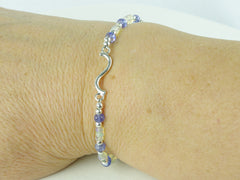 Curve Bracelet - Tanzanite, Ethiopian Opal, Sterling Silver shown worn