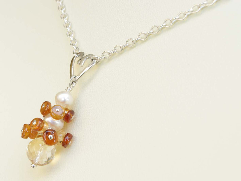 Diana necklace. Hessonite garnets, with a white freshwater cultured pearl and citrine. Suspended from a polished sterling silver handmade heart on a sterling silver chain. Jewellery by Linda Sweet Heart Collection. 46cm chain. 3.5cm pendant