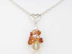 Diana necklace. Hessonite garnets, with a white freshwater cultured pearl and citrine. Suspended from a polished sterling silver handmade heart on a sterling silver chain. Jewellery by Linda Sweet Heart Collection. 46cm chain.