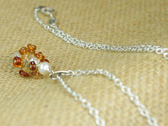 Diana necklace. Hessonite garnets, with a white freshwater cultured pearl and citrine. Suspended from a polished sterling silver handmade heart on a sterling silver chain. Sweet Heart Collection at Jewellery by Linda. 46cm chain. 3.5cm pendant